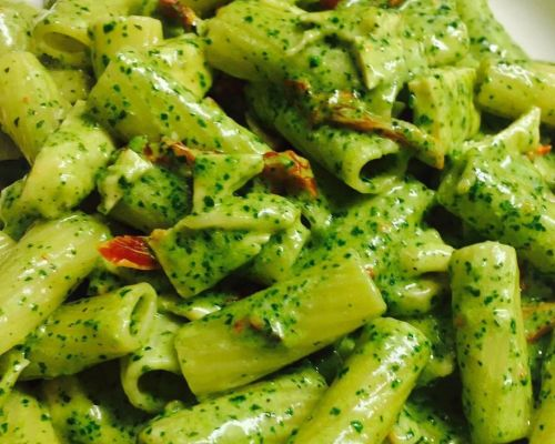 green pasta boxed meal with protein