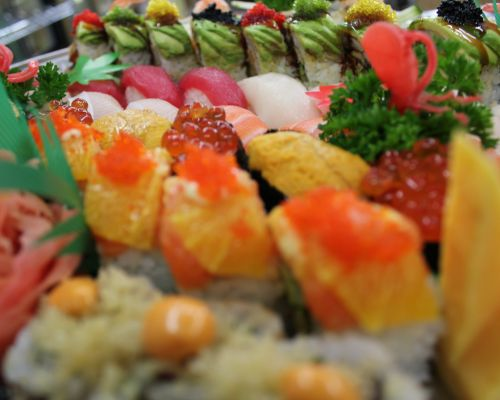 family sushi party catering food